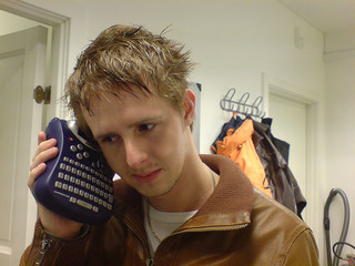 Young man with label maker